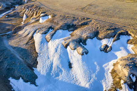 arroyo in Pawnee National Grassland in northern Colorado, early spring scenery, aerial view