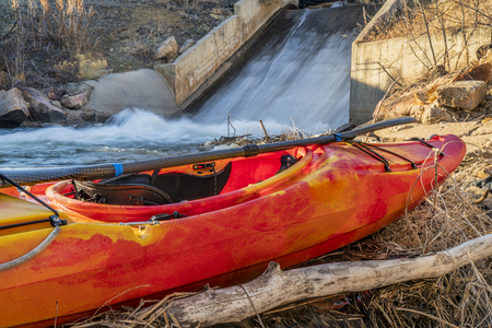 whitewater kayak at a dam - water inlet to Boedecker reservoir in northern Colorado