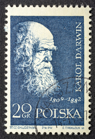 Charles Darwin, English naturalist, geologist and biologist,  portrait on a vintage, canceled post stamp from Poland (circa 1959).