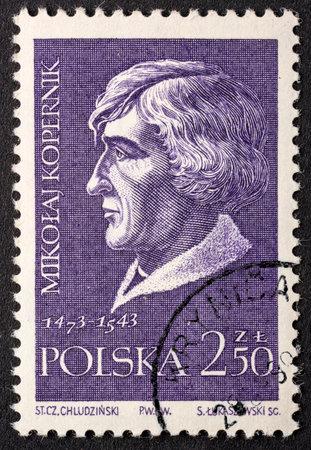 Nicolaus Copernicus (Mikołaj Kopernik), astronomer,  portrait on a vintage, canceled post stamp from Poland (circa 1959).