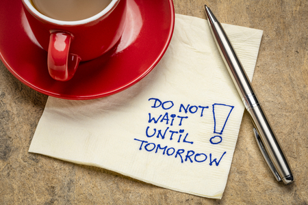 Do not wait until tomorrow - motivational advice  on a napkin with a cup of coffee