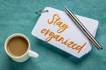 Stay organized - reminder on a stack of index cards with a cup of coffee