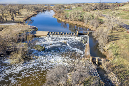 water diversion dam on the South Platte River abover Brigthon, Colorado - aerial in early spring scenery