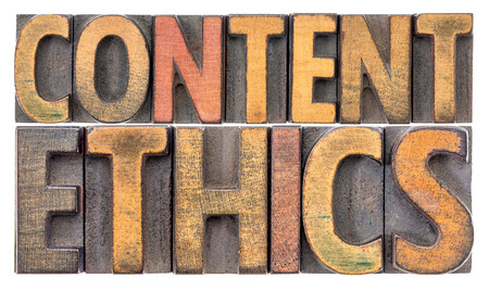 content ethics - isolated word abstract in vintage letterpress wood type Banco de Imagens