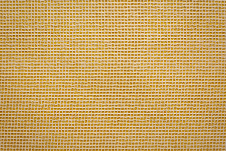 white Thai mulberry lace paper with a grid pattern against orange background Stockfoto