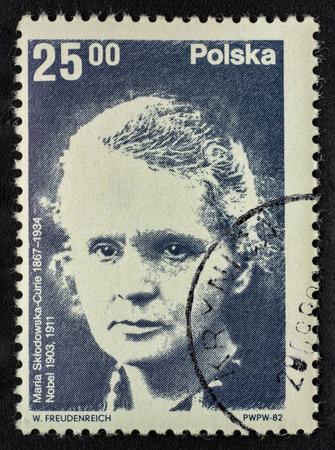 Maria Sklodowska Curie portrait on a vintage (1982), canceled post stamp from Poland Imagens - 120528777