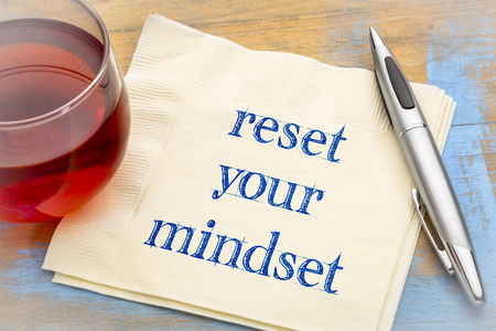 reset your mindset advice - handwriting on a napkin with a cup of tea