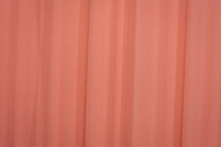 salmon color crepe paper - background with crinkled texture
