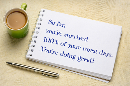 so far, you have survived 100% of your worst days. You are doing great. Positive handwriting in a spiral sketchbook with a cup of coffee