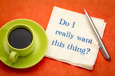 Do you really want to do this? Handwriting on a napkin with a cup of coffee. Imagens