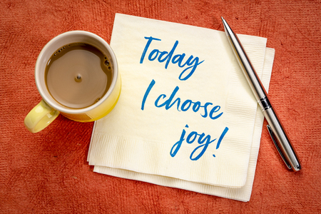 Today I choose joy - positive affirmation handwriting on a napkin with a cup of coffee