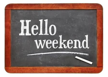 Hello weekend - white chalk text on a vintage slate blackboard
