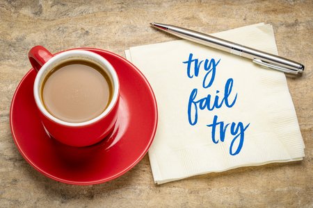 try, fail and try again concept - handwriting on napkin with a cup of coffee Stok Fotoğraf