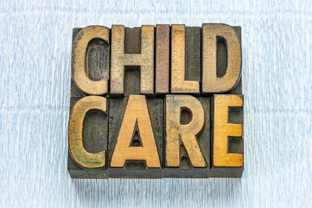 child care word abstract in vintage letterpress wood type printing blocks