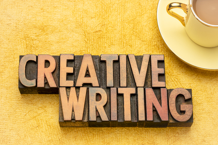 creative writing word abstract in vintage letterpress wood type with a cup of coffee