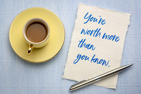 You are worth more than you know - handwriting on a piece of handmade rag paper with a cup of coffee Stock fotó