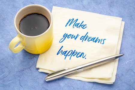 Make your dreams happen - handwriting on a napkin with a cup of coffee Фото со стока