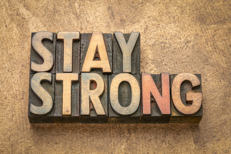 stay strong  - word abstract in vintage letterpress wood type