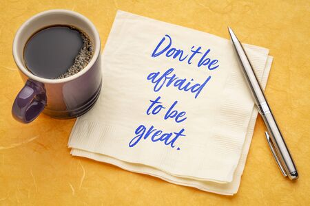 Do not be afraid to be great - inspirational handwriting on napkin with a cup of coffee Reklamní fotografie
