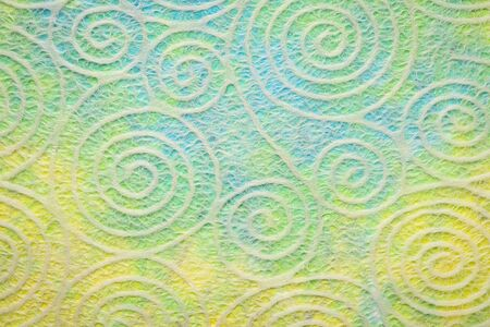 Japanese Washi tissue with white Uzumaki pattern spirals against marbled mulberry paper Фото со стока