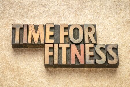 time for fitness - word abstract in vintage letterpress wood type printing blocks Zdjęcie Seryjne - 124997582