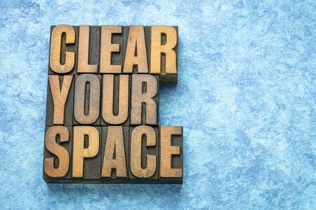 clear your space  - word abstract in vintage letterpress wood type printing blocks