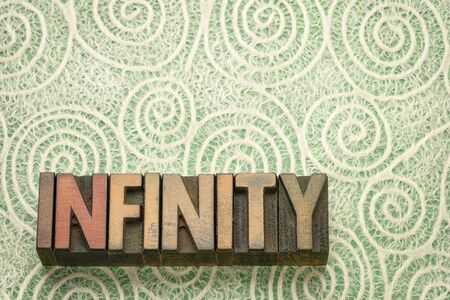 infinity word abstract in vintage letterpress wood type printing blocks