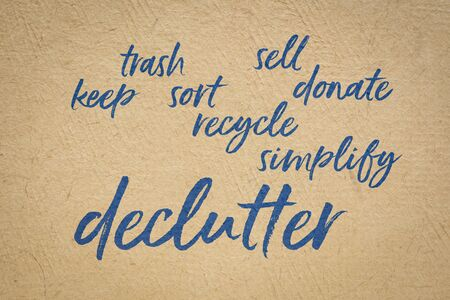 declutter and simplify  word cloud - handwriting on a handmade bark paper