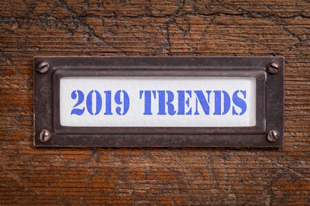 2019 trends - a label on grunge wooden file cabinet.