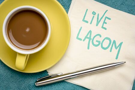 live Lagom, not too little, not too much, just right - Swedish philosophy for a balanced life, handwriting on a napkin with a cup of coffee