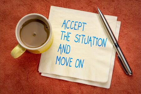 Accept the situation and move on - Handwriting on a napkin with a cup of coffee Banco de Imagens