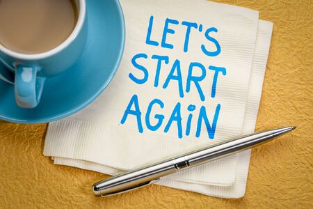 Let's start again note - Motivational handwriting on a napkin with a cup of coffee
