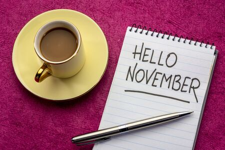 Hello November - handwriting in a notebook with a cup of coffee