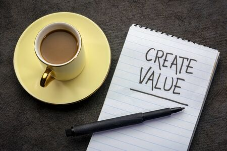 create value - motivational handwriting in a spiral notebook with a cup of tea