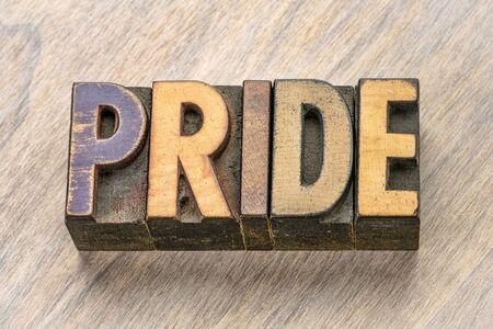 pride word abstract in vintage letterpress wood type