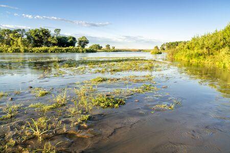 shallow and wide Dismal RIver meandering trough Nebraska Sandhills at Nebraska National Forest, summer scenery