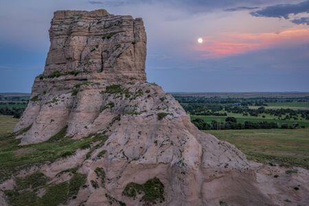 full moon rise over Jail Rock on Nebraska Panhandle Stock Photo