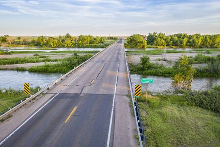 highway and bridge over the South Platte River in Nebraska at Brule, aerial view with summer scenery