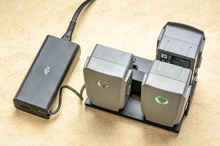 Fort Collins, CO, USA - February 10, 2019:  Charging DJI smart batteries for  Mavic 2 quadcopter drone.