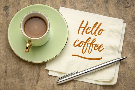 Hello coffee - cheerful handwriting on a napkin with a cup of coffee Stockfoto