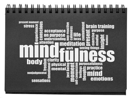 mindfulness word cloud - white text in an isolated black paper sketchbook