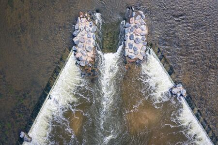boat chute with a surfing wave on a river  dam - South Platte River in northern Colorado, aerial view Stock Photo