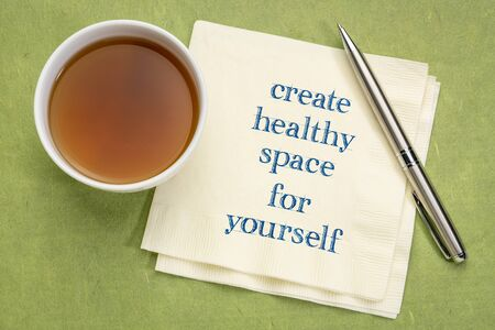 create healthy space for yourself - inspirational text on a napkin with a cup of tea