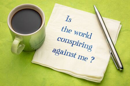 Is the world conspiring against me? A question on a napkin with a cup of coffee