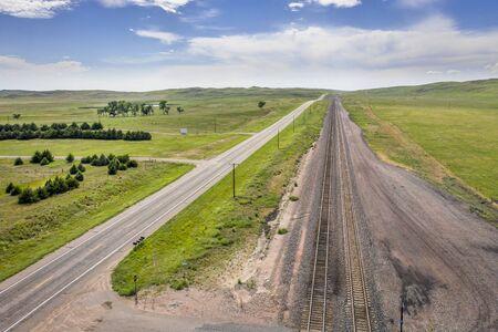 empty highway and railroad in Nebraska Sandhills, aerial view of summer scenery