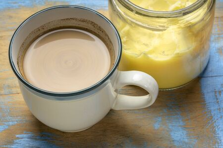 cup of fresh fatty coffee with ghee (clarified butter), MCT oil and cinnamon - ketogenic diet concept