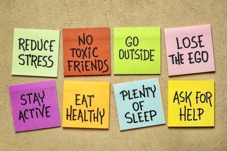 healthy lifestyle reminders - handwriting on a set of colorful sticky notes against textures paper Stok Fotoğraf
