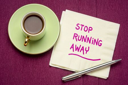 stop running away - motivational handwriting on a napkin with a cup of coffee