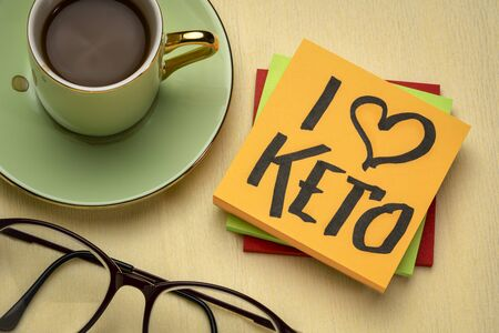 I love keto - diet and lifestyle concept - handwriting on a napkin with a cup of coffee Stock Photo