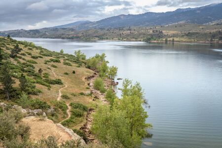 mountain lake, Horsetooth Reservoir in northern Colorado near Fort Collins, on a calm summer morning